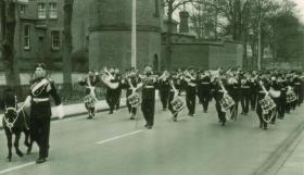 The Mascot leads the way as 1 PARA marching out of the barracks to receive the Freedom of Aldershot, September 1957