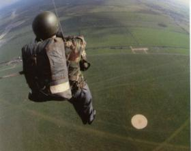 Undertaking a parachute drop from training balloon