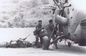 Paras loading a resupply helicopter on the Tolo Peninsular, Hong Kong, 1980