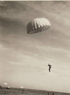 Paratrooper descends at RAF Aqir, Palestine, c.1946-7