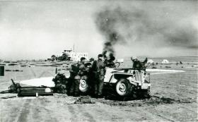 Paratroopers surround a jeep on El Gamil airfield, November 1956