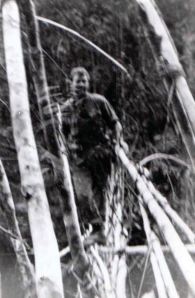Para Guardsman on jungle bridge crossing, Sarawak, Borneo, 1964