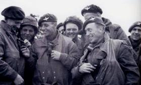 Paratroopers of 6th Airborne Division check each others jumping gear prior D-Day, June 1944