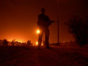 Para silhouette on a night patrol, Iraq, Op Telic 7, 2006