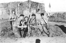 Pte Frost with friends dig in at El Cap, Suez, 1956