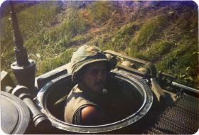 Pte Lee Crichton driving an Armoured Personnel Carrier in the US, 1983