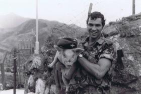Pte Wells with 'Billy', B Coy 1 PARA mascot, in mountain border region, Hong Kong, 1980