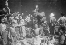 Punan villagers see off Guards Para Coy 98 Patrol as it leaves Long Luar, Sarawak, Borneo, 1964