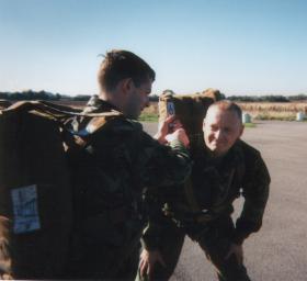 Pte Riley 4 PARA checking my parachute, 1996