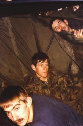 Stephen Prior (bottom) and two comrades in makeshift sleeping quarters.