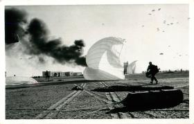 Paratroopers of A Company, 3 PARA move in to take the airport centre of El Gamil airfield while other men are still descending.