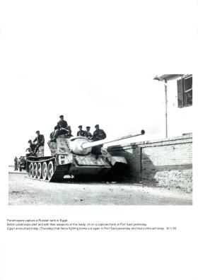 Paratroopers capture a Russian SU-100 tank in Port Said.