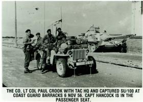 Lieutenant Paul Crook (left) with Tactical HQ at Coast Guard Barracks, November 6, 1956.