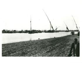 Egyptians evacuate Port Said from the Falucca harbour.
