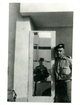 Two paratroopers pose with a mirror in a Port Said flat.