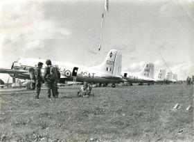 Men of 3 PARA in Nicosia, Cyprus beside the Hastings aircraft that will drop them at El Gamil airfield.