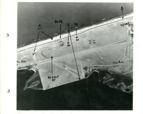 Aerial shot of El Gamil Airfield annotated to show drop zone, rendezvous points, and direction of fly in.