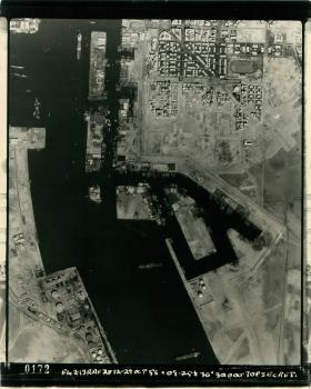 Aerial shot of Port Said showing part of the Suez Canal and surrounding buildings and land.