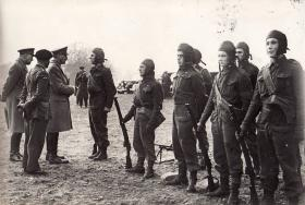 Gen Dill inspects men of No 2 Commando Lt Col Jackson in attendance