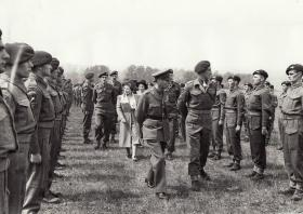 Col Pine-Coffin escorting the King & Queen during an inspection of 7 Bn, 1943