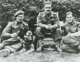 Members of 13 Parachute Battalion relax with a Para dog, 1945.