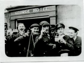 Servicemen celebrate VE Day, May 1945
