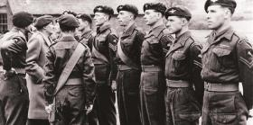 Montgomery talks to Sgt Philip McDonnell, with other NCOs of the 3rd Parachute Battalion.