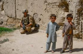 Soldier with Children in Kandahar City, June 2008