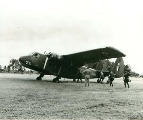 Soldiers about to emplane to a Prestwick Twin Pioneer aircraft