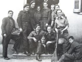 Soldiers of 4 Para Bn relax with locals in an Athens suburb, Greece, January 1945