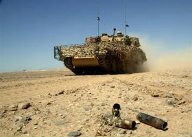 Spent rounds litter the desert as a Scimitar of D Squadron, HCR passes, Afghanistan
