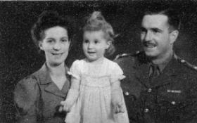 Studio photo of Stanley Growdon with family, Durban, South Africa, 1945