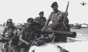 1 Para Anti Tank Team, notice behind them are the Buffalo landing craft from WW2
