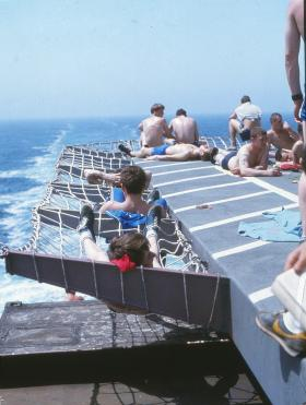 Sunbathing as Norland crosses the equator. Silly boys. MV Norland, 1982.