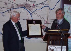 Tony Hibbert presenting his Military Cross to the Airborne Museum Hartenstein, 18 September 2009