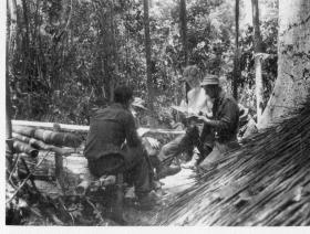 A Guards Company Patrol going over the days work, Malaya, 1964