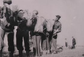 CSM Ted Dent checking parachutes of a stick from the 10th (TA) Battalion at their annual camp, April 1949
