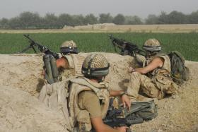 Soldiers of C Coy, 2 PARA provide fire support during an engagement with the Taliban, FOB Gibraltar, Afghanistan, July 2008