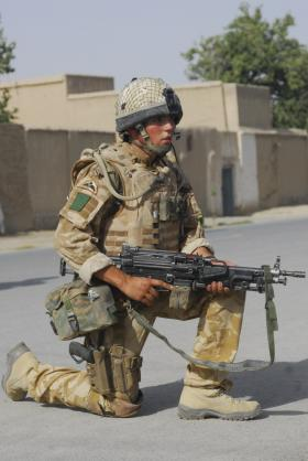 Soldier of A Coy, 3 PARA pauses to survey the area on patrol in Kandahar, Afghanistan, June 2008