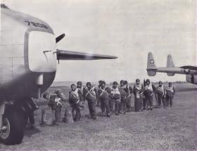 A stick from 45th Parachute Brigade about to emplane a C119 Boxcar, Ex Spearhead 1952