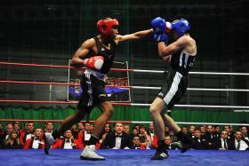 Pte Barry (red gloves) in the semi-final of the Army Major Units Boxing Championship, Colchester, 29 February 2012.