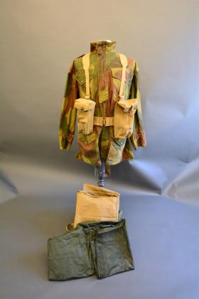 37 Pattern Waist Belt, Braces and Basic Pouches connected and worn on the mannequin from the Airborne Assault Museum, Duxford.