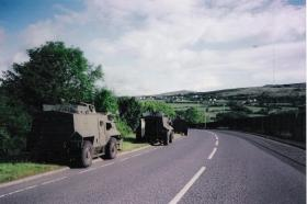 AT105 Saxons with 2 PARA on the Colin Glen Road, north of Poleglass, 1993.