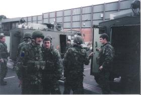 LCpl Dave Arnold and Cpl Moose Millar, 2 PARA, in front of an AT 105 Saxon, Woodbourne RUC Station, July 1993.