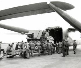 Artillery piece being loaded onto a C119 at RAF Boscombe Down, 1950.