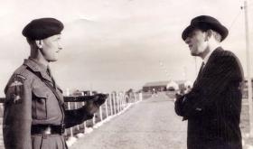 RSM Alcock talks to fellow past guardsman, Cyprus, c1956.