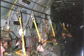 Sgt D Curtin, Lcpl Adron Goddard and Lcpl A Gillespie of 144 Parachute Medical Squadron trying out the LLP, c 1990.