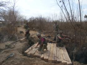 Engineers from 9 Para Sqn RE, put the finishing touches to a new bridge, Afghanistan, 2011