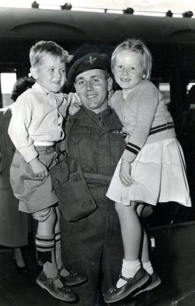 Peter Malone saying goodbye to two of his children, Aldershot train station on the way to Suez, 1956.