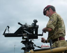 L/Cpl Allen demonstrating the .50 cal machine gun to members of the public IWM Duxford, 17 June 2012.